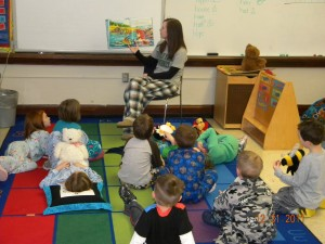 The kindergartners get cozy with Ms. Wiese and a good book.